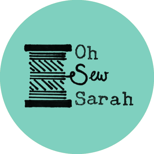 Illustration of a cotton bobbin with some wording next to it. The thread spells our the word 'Sew'. Some old typewriterlettering completes the message 'Oh Sew Sarah'.